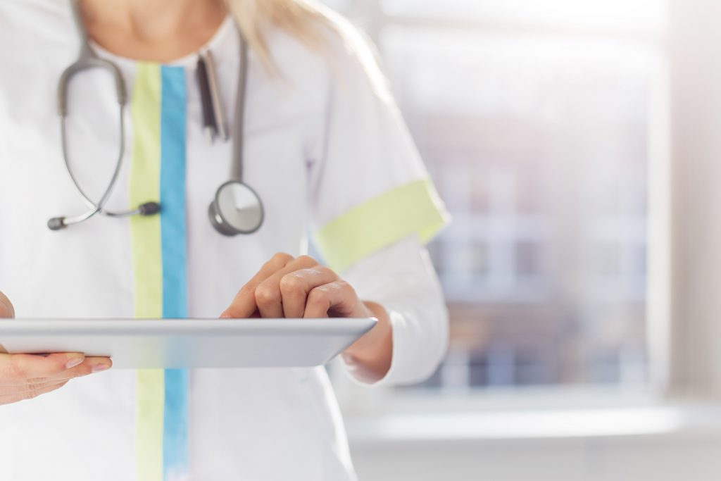 Female Healthcare Professional using a Tablet to Monitor Patient data