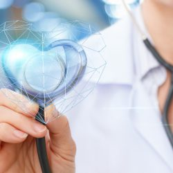 Doctor holding up heart-shaped high-tech stethoscope