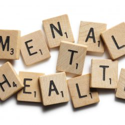 Scrabble tiles spelling out mental health