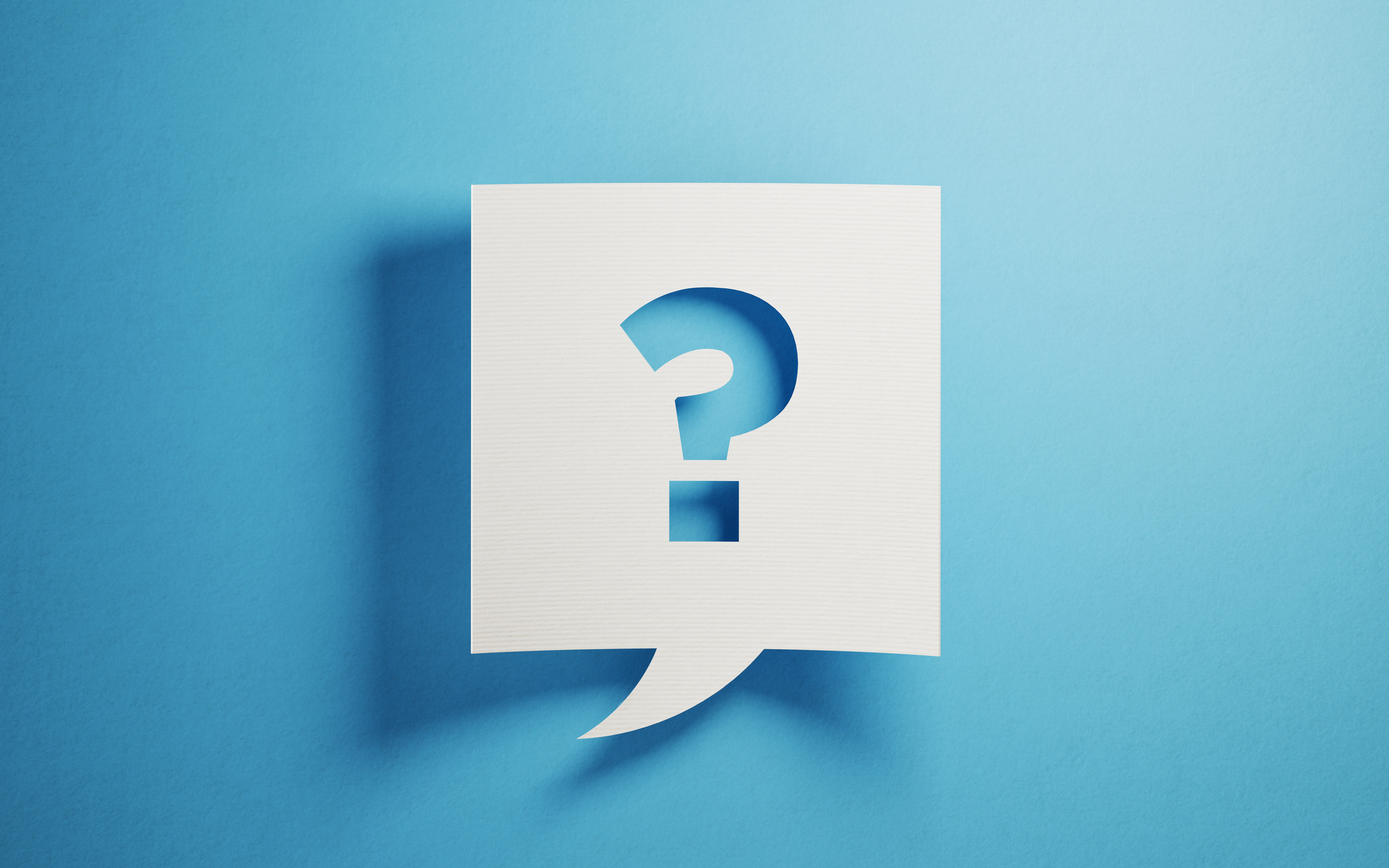 Chat bubble with question mark on blue background.