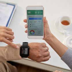 Heart rate displayed on smart watch with patient monitoring app on connected smart phone.