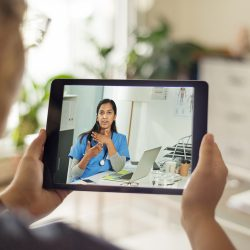 Patient conferencing with her doctor on a mobile device