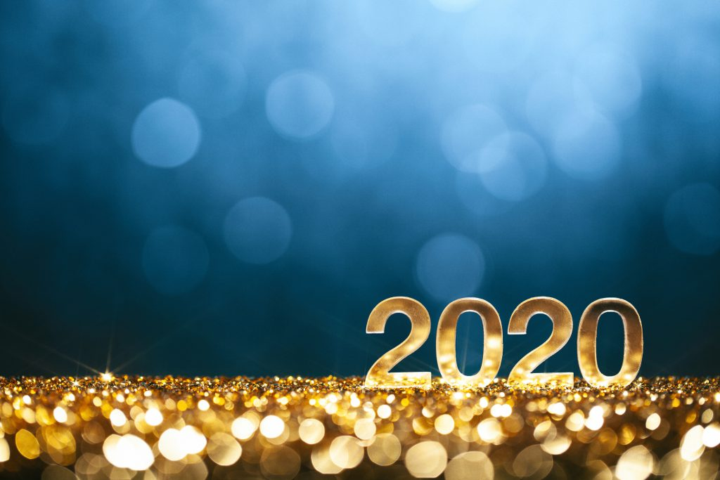 Golden 2020 block numbers on gold coins in front of a blue background