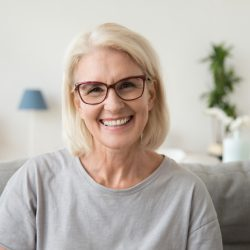 Smiling middle aged mature grey-haired woman looking at camera