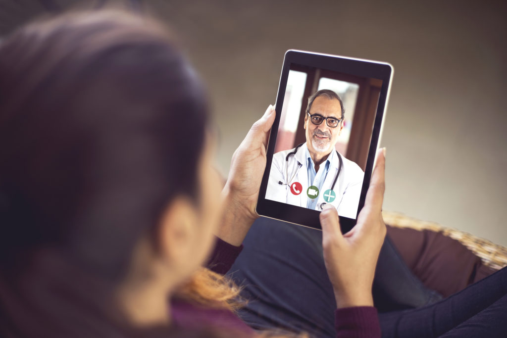 Woman on telehealth visit on tablet