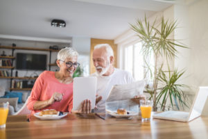 older adults reviewing information on tablet