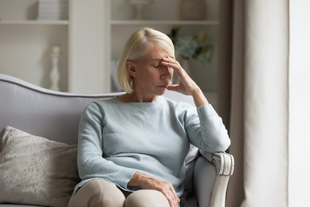 Woman at home with chronic headache