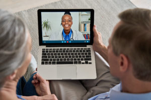 Couple on virtual video visit with female doctor